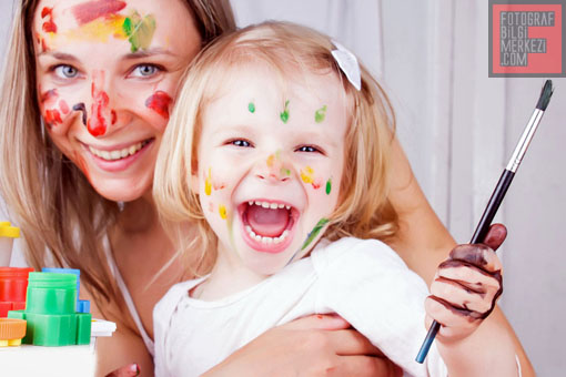 Happy mother and daughter painting